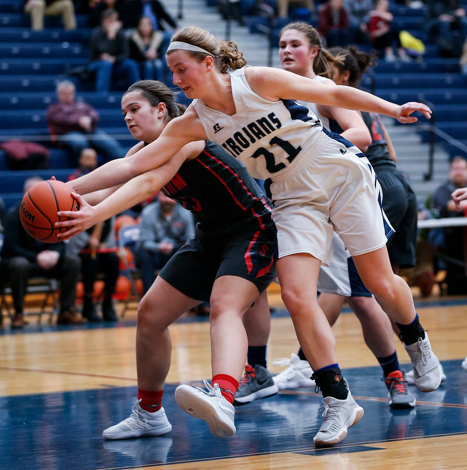 Katie Sowa (21) from Cary-Grove reaches for a rebound with Megan McClure (23) from South Elgin in the second quarter of their Class 4A South Elgin Regional game on Tuesday, February 13, 2018 in South Elgin, Illinois. The Trojans defeated the Storm 69-37. John Konstantaras photo for Shaw Media
