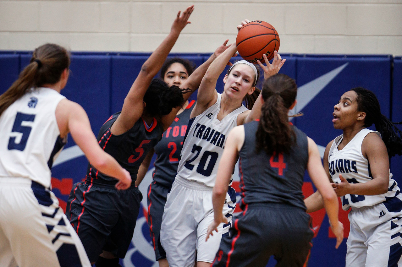 Abby Getka (20) from Cary-Grove grabs a rebound from Catora Brown (5) from South Elgin in the third quarter of their Class 4A South Elgin Regional game on Tuesday, February 13, 2018 in South Elgin, Illinois. The Trojans defeated the Storm 69-37. John Konstantaras photo for Shaw Media