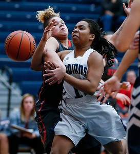 Vanessa Morris (10) from Cary-Grove is fouled by Miah Galvin (44) from South Elgin as she drives to the basket in the first quarter of their Class 4A South Elgin Regional game on Tuesday, February 13, 2018 in South Elgin, Illinois. The Trojans defeated the Storm 69-37. John Konstantaras photo for Shaw Media