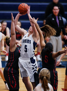 Maddie Jannusch (5) from Cary-Grove drives to the basket between Miah Galvin (left, 44) and Catora Brown (5) from South Elgin in the second quarter of their Class 4A South Elgin Regional game on Tuesday, February 13, 2018 in South Elgin, Illinois. The Trojans defeated the Storm 69-37. John Konstantaras photo for Shaw Media