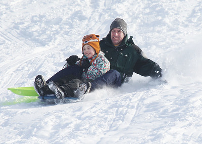 Candace H. Johnson-For Shaw Media Lila Ernst, 10, of Grayslake and her father, Terrence, sled down Hart's Hill in Round Lake.(2/11/18)