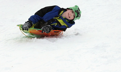 Candace H. Johnson-For Shaw Media Gavin Schick, 8, of Round Lake Heights goes down the sled hill at Caboose Park in Lake Villa.(2/10/18)