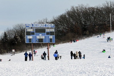 Candace H. Johnson-For Shaw Media The Ron Schmidt Field is covered in snow with people sledding down Hart's Hill in Round Lake.
