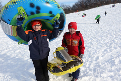 Candace H. Johnson-For Shaw Media David McNeil, 10, of Round Lake and his brother, Jay, 8, show the different sleds they use to go down Hart's Hill in Round Lake.(2/11/18)
