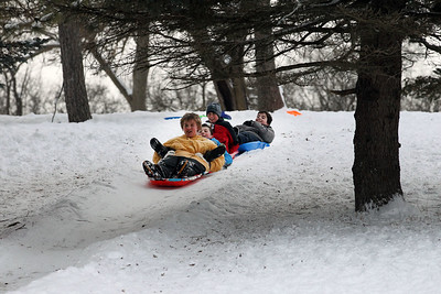 Candace H. Johnson-For Shaw Media Ian Murphy, 12, Micah Lind, Luke Etienne, and Mason Eckert, all 13, and all from Lindenhurst have fun sledding down the sled hill together at Caboose Park in Lake Villa. It was a birthday weekend for Ian Murphy.(2/10/18)
