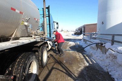 Candace H. Johnson-For Shaw Media Jeff Spoonmore, of Ashley, Ind., with Klink Trucking, hooks up a hose to connect the Beet Heet liquid in his truck to the tank fill station at the Lake County Division of Transportation on Winchester Road in Libertyville.Beet Heet is derived from beets and is used to help melt the ice and snow from the roads.(2/12/18)