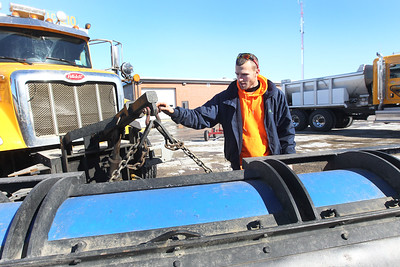 Candace H. Johnson-For Shaw Media Michael Vidakovic, of Zion, a Lake County Highway maintenance worker, checks over a snow plow at the Lake County Division of Transportation on Winchester Road in Libertyville.(2/12/18)