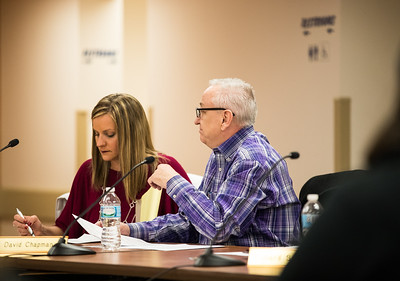 Whitney Rupp for Shaw Media Algonquin Township board members Melissa Victor, left, and Dave Chapman review papers during the Feb. 14 board meeting.