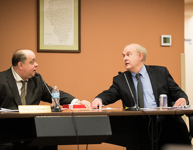 Whitney Rupp for Shaw Media Algonquin Township Supervisor Charles A. Lutzow Jr., left, and Township Attorney Jim Kelly confer during a board meeting Wednesday, Feb. 14.