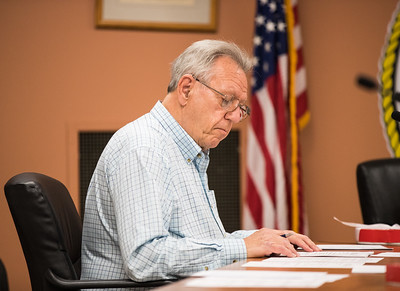 Whitney Rupp for Shaw Media Daniel Shea, Algonquin Township Trustee, reviews paperwork at the Feb. 14 board meeting.