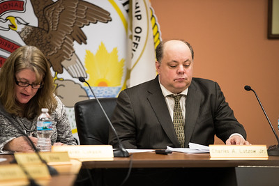 Whitney Rupp for Shaw Media Karen Lukasik, Algonquin Township Clerk, and Charles A. Lutzow Jr., Township Supervisor, attend the Feb. 14 board meeting.
