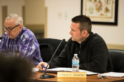 Whitney Rupp for Shaw Media Algonquin Township Assessor Richard Alexander, listens to a speaker at the board meeting Wednesday, Feb. 14.
