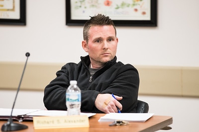 Whitney Rupp for Shaw Media Algonquin Township Assessor Richard Alexander listens to a speaker at the board meeting Wednesday, Feb. 14.