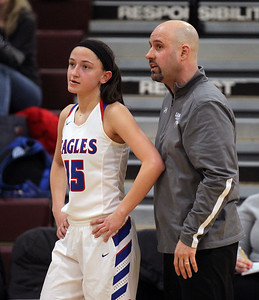 Candace H. Johnson-For Shaw Media Lakes Sara Smith talks with Brian Phelan, head coach, as her basketball team plays against Antioch at the end of the third quarter during the Class 3A regional semi-final game at Antioch Community High School. Lakes won 50-38.(2/13/18)