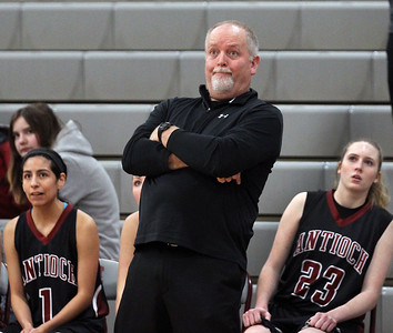 Candace H. Johnson-For Shaw Media Antioch's Tim Borries, head coach, stands near Amy Vasquez and Miranda Chamberlin as he watches one of his players make a shot in the third quarter during the Class 3A regional semi-final game at Antioch Community High School. Lakes won 50-38.(2/13/18)
