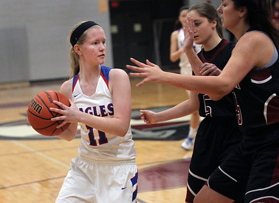 Candace H. Johnson-For Shaw Media Lakes Anna Wallenfang looks to pass against Antioch's Becca Ustich and Skylar Del'ao in the fourth quarter during the Class 3A regional semi-final game at Antioch Community High School. Lakes won 50-38.(2/13/18)