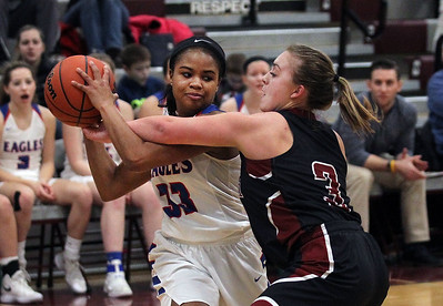 Candace H. Johnson-For Shaw Media Lakes Brittany Washington takes control of the ball against Antioch's Taylor Feltner in the first quarter during the Class 3A regional semi-final game at Antioch Community High School. Lakes won 50-38.(2/13/18)