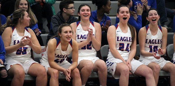 Candace H. Johnson-For Shaw Media A group of Lakes girls varsity basketball players cheer from the bench as their team plays against Antioch in the first quarter during the Class 3A regional semi-final game at Antioch Community High School. Lakes won 50-38.(2/13/18)