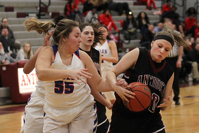 Candace H. Johnson-For Shaw Media Lakes Caitlin Rodriguez and Antioch's Kaitlynn Stay battle for a rebound in the first quarter during the Class 3A regional semi-final game at Antioch Community High School. Lakes won 50-38.(2/13/18)