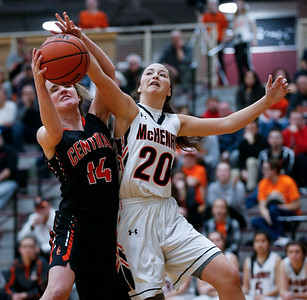 Emma Fleming (14) from Crystal Lake Central and Ava Interrante (20) from McHenry battle for a rebound in the second quarter during their IHSA Class 4A girls basketball regional championship game on Thursday, February 15, 2018, in Crystal Lake, Illinois.  The Warriors defeated the Tigers. John Konstantaras photo for Shaw Media