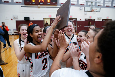 McHenry players celebrate their IHSA Class 4A girls basketball regional championship over Crystal Lake Central  on Thursday, February 15, 2018, in Crystal Lake, Illinois.  The Warriors defeated the Tigers. John Konstantaras photo for Shaw Media