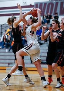 Liz Alsot (44) from McHenry grabs a rebound between Crystal Lake Central defenders in the third quarter during their IHSA Class 4A girls basketball regional championship game on Thursday, February 15, 2018, in Crystal Lake, Illinois.  The Warriors defeated the Tigers. John Konstantaras photo for Shaw Media