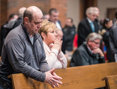 Whitney Rupp for Shaw Media Kevin and Carol Anderson of Crystal Lake attend Ash Wednesday service at St. Thomas the Apostle Church in Crystal Lake.