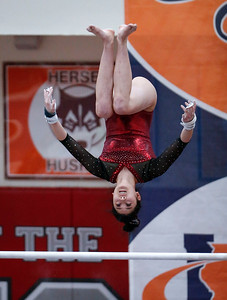 Maddy Kim from Prairie Ridge competes on uneven bars during the IHSA State Gymnastics Championship on Friday, February 16, 2018, in Palatine, Illinois. John Konstantaras photo for Shaw Media