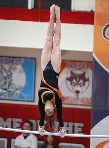 Lauren Leman from DeKalb competes on uneven bars during the IHSA State Gymnastics Championship on Friday, February 16, 2018, in Palatine, Illinois. John Konstantaras photo for Shaw Media