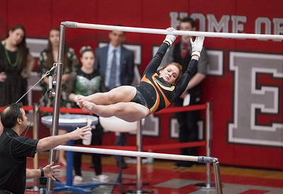 Whitney Rupp for Shaw Media DeKalb's Lauren Leman performs on the uneven bars Saturday, Feb. 17 in Palatine at the IHSA State Finals.