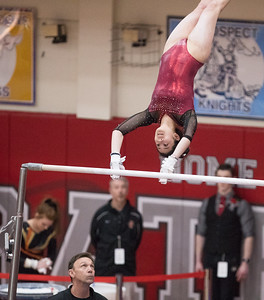 Whitney Rupp for Shaw Media Prairie Ridge's Maddy Kim performs for a first place finish on the uneven bars in the event finals Saturday, Feb. 17 at the IHSA State Championship.
