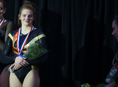 Whitney Rupp for Shaw Media DeKalb's Lauren Leman takes the podium after finishing fifth on uneven bars with a 9.4500 Saturday, Feb. 17 in Palatine at the IHSA State Finals.