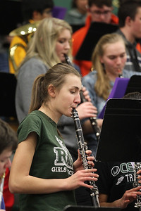 Candace H. Johnson-For Shaw Media Grayslake Central's Kristina Galeczka, 16, plays her clarinet with the Pep Band during the boys varsity basketball game against Wauconda at half-time at Grayslake Central High School.(2/20/18)