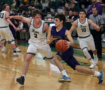 Candace H. Johnson-For Shaw Media Wauconda's Nick Richiuso drives to the basket against Grayslake Central's Alec Novak (#3) in the third quarter at Grayslake Central High School. Wauconda won 51-43.(2/20/18)