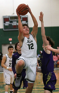 Candace H. Johnson-For Shaw Media Grayslake Central's Christopher Thomas leaps up for a shot against Wauconda's Nicholas Bulgarelli in the first quarter at Grayslake Central High School. Wauconda won 51-43.(2/20/18)
