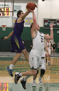 Candace H. Johnson-For Shaw Media Wauconda's Nick Rinchiuso blocks a shot by Grayslake Central's Alec Novak in the first quarter at Grayslake Central High School. Wauconda won 51-43.(2/20/18)