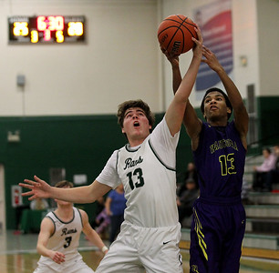 Candace H. Johnson-For Shaw Media Grayslake Central's Jack Spalding defends a shot by Wauconda's Donovan Carter in the third quarter at Grayslake Central High School. Wauconda won 51-43.(2/20/18)