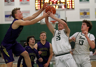 Candace H. Johnson-For Shaw Media Wauconda's Matthew Nolan battles for a rebound with Grayslake Central's Jack Fortmann in the second quarter at Grayslake Central High School. Wauconda won 51-43.(2/20/18)