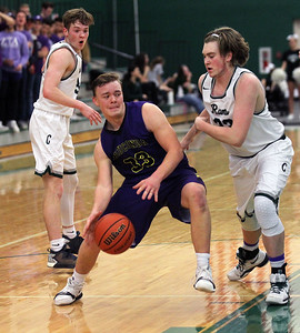 Candace H. Johnson-For Shaw Media Wauconda's Andrew Nolan (#33) drives to the basket against Grayslake Central's Alec Novak and Coby Moe in the third quarter at Grayslake Central High School. Wauconda won 51-43.(2/20/18)