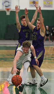 Candace H. Johnson-For Shaw Media Grayslake Central's Alec Novak scrambles for a loose ball as Wauconda's Nicholas Bulgarelli and Andrew Nolan defend at Grayslake Central High School. Wauconda won 51-43.(2/20/18)