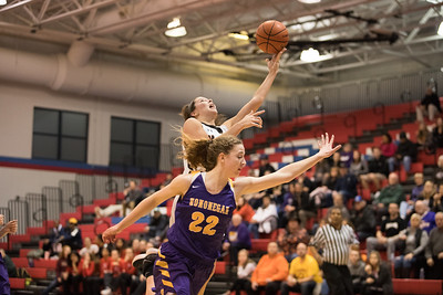 Whitney Rupp for Shaw Media McHenry's Aannah Interrante goes in for a basket against Hononegah's Cali Schmitz at the Class 4A Sectional Feb. 20.