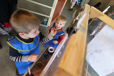 Candace H. Johnson-For Shaw Media Harrison Davis, 2, of Gurnee (on right) watches his brother, Jordy, 4, paint a picture at the Kohl Children's Pop-Up Museum in Waukegan.The brothers were at the pop-up museum with their parents, Tyler and Maren.(2/17/18)