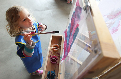 Candace H. Johnson-For Shaw Media Isabella Ohrvall, 3, of Great Lakes paints a picture at the Kohl Children's Pop-Up Museum at 220 W. Clayton Street in Waukegan.Isabella was at the pop-up museum for the first time with her mother, Jennifer.(2/17/18)