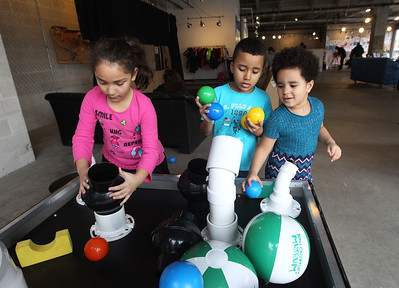 Candace H. Johnson-For Shaw Media Ruby Torres, 7, and her sister, Sky Wade, 5, both of Gurnee play at the Bernoulli blower table with their cousin, Christopher Torres, 6, of Waukegan (center) at the Kohl Children's Pop-Up Museum in Waukegan.(2/17/18)