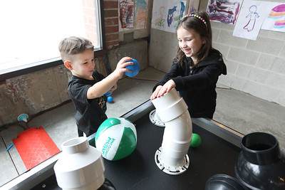 Candace H. Johnson-For Shaw Media Dax Truax, 4, of Gurnee and his sister, Finley, 6, play with balls as they send them soaring into the air at the Bernoulli blower table at the Kohl Children's Pop-Up Museum on 220 W. Clayton Street in Waukegan.(2/17/18)