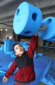 Candace H. Johnson-For Shaw Media Kalixo Mejia, 6, of Waukegan uses his strength to lift a giant foam barbell in the Imagination Playground at the Kohl Children's Pop-Up Museum in the Urban Edge building at 220 W. Clayton Street in Waukegan.(2/17/18)