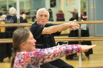 Candace H. Johnson-For Shaw Media Chuck McCann, of Round Lake Beach watches Carol Kiraly, instructor, as the class works on shoulder shrugs during Yoga for Seniors at the Robert W. Rolek Community Center in Round Lake.(2/20/18)