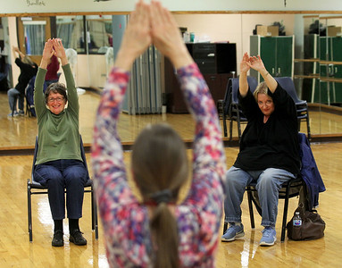 Candace H. Johnson-For Shaw Media Marcene Tekampe, of Grayslake and Cindy Voorbach, of Round Lake Park watch Carol Kiraly, instructor, (center) as they practice stretching exercises during Yoga for Seniors at the Robert W. Rolek Community Center in Round Lake.(2/20/18)