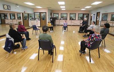 Candace H. Johnson-For Shaw Media Instructor Carol Kiraly, of McHenry leads the Yoga for Seniors class as everyone sits in a circle to work on their heart, mind, body and soul at the Robert W. Rolek Community Center in Round Lake.(2/20/18)