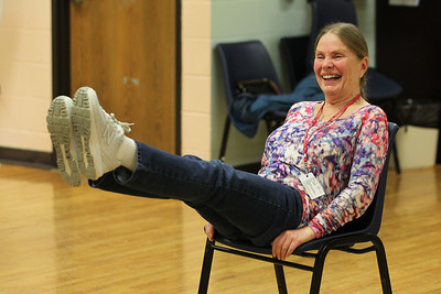 Candace H. Johnson-For Shaw Media Instructor Carol Kiraly, of McHenry works with her Yoga for Seniors class on an exercise to strengthen the oblique muscles at the Robert W. Rolek Community Center in Round Lake.(2/20/18)
